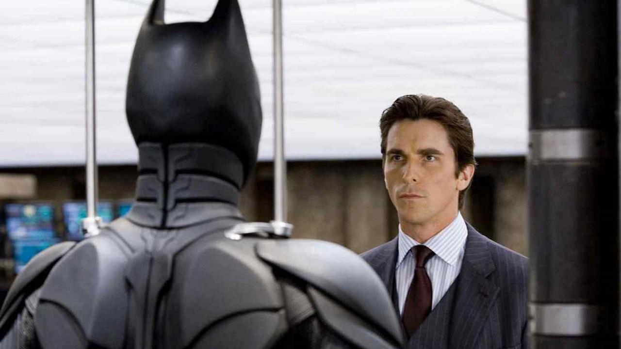 bruce-wayne-looking-at-batman-costume